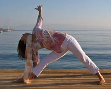 triangle pose expanding the arms from the core